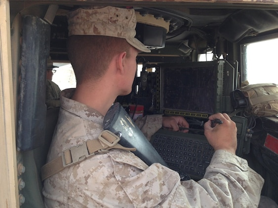 A Marine with the 2nd Battalion, 8th Marine Regiment from Camp Lejeune, North Carolina, operates Joint Battle Command-Platform inside a vehicle during Network Integration Evaluation 14.2 at Fort Bliss, Texas. About 900 Marines joined the Soldiers of the 2nd Brigade Combat Team, 1st Armored Division at the evaluation, which serves as an operational laboratory to incrementally enhance the Army's tactical network. JBC-P, a new situational awareness capability for the Army and Marine Corps, is built with today's force in mind featuring touch-to-zoom maps, drag-and-drop icons and a Google Earth-like interface.