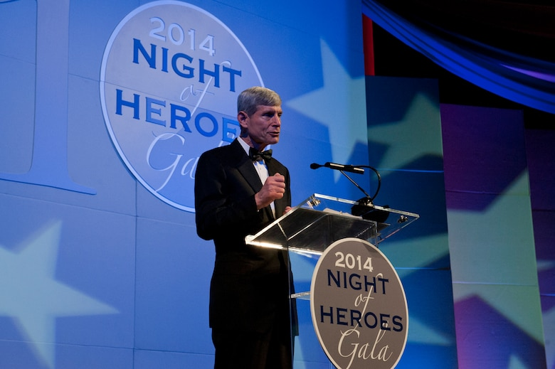 Nineteenth Chief of Staff of the Air Force retired General Norton A. Schwartz makes opening remarks for the American Hero Award during the PenFed Foundation's Night of Heroes Gala May 14, 2014, before presenting the award to the Secretary of the Air Force Deborah Lee James. (U.S. Air Force photo/Staff Sgt. Carlin Leslie)