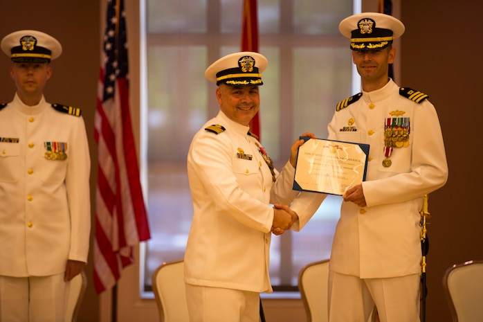 Cmdr. Scott Cloyd, the outgoing officer in charge of construction, receives an award during the disestablishment ceremony of Marine Corps Installations East Officer in Charge of Construction office at the Marston Pavilion aboard Marine Corps Base Camp Lejeune, May 6. The OICC was a unique office created to manage a large influx in construction during the last six years. Cloyd has led the OICC for the last two years.