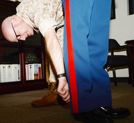 Lt. Col. Daniel Bates, executive officer, Marine Corps Logistics Base Albany, inspects the trousers of Capt. Marc Blair, deputy operations officer, MCLB Albany, as part of the inspector general program inspection, May 9.
