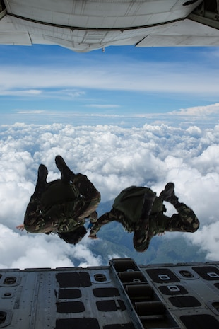 "Philippine Army Special Forces freefall jumpers with Special Operations Command, stationed at Fort Magsaysay jump from a KC-130J ""Sumos"", assigned to Marine Aerial Refueler Transport Squadron 152, Marine Aircraft Group 36, 1st Marine Aircraft Wing, based at Marine Corps Air Station Futenma, Okinawa, Japan, during High Altitude Low Opening military freefall jumps during Balikatan 2014 at Fort Magsaysay, Republic of the Philippines, May 14, 2014. This year marks the 30th iteration of Balikatan, which is an annual Republic of the Philippines-U.S. military bilateral training exercise."