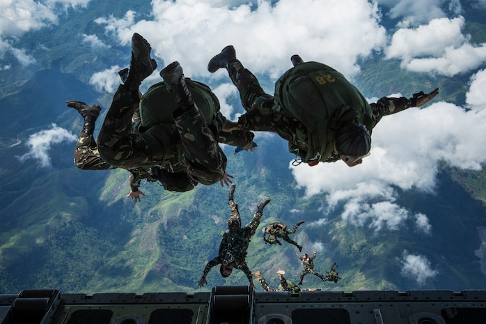 "Philippine Army Special Forces freefall jumpers with Special Operations Command, stationed at Fort Magsaysay jump from a KC-130J ""Sumos"", assigned to Marine Aerial Refueler Transport Squadron 152, Marine Aircraft Group 36, 1st Marine Aircraft Wing, based at Marine Corps Air Station Futenma, Okinawa, Japan, during High Altitude Low Opening military freefall jumps during the Combined Arms Live Fire Exercise for Balikatan 2014 at Crow Valley, Republic of the Philippines, May 15, 2014. This year marks the 30th iteration of Balikatan, which is an annual Republic of the Philippines-U.S. military bilateral training exercise."