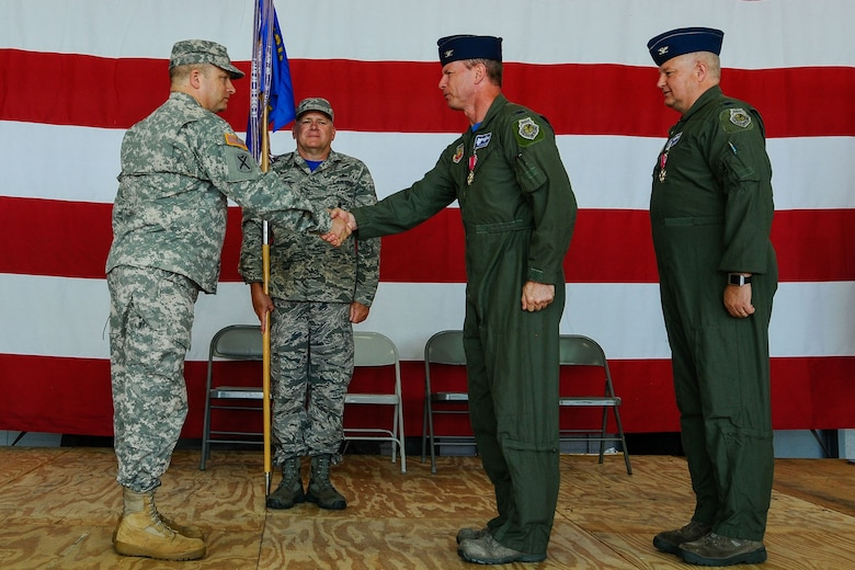 U.S. Army Maj. Gen. Robert E. Livingston Jr., The Adjutant General of South Carolina, congratulates Col. David Meyer, the new commander of the 169th Fighter Wing. U.S. Airmen of the 169th Fighter Wing and the South Carolina Air National Guard, assemble for a change of command ceremony at McEntire Joint National Guard Base, S.C., May 3, 2014. Col. Michael Manning relinquishes command of the wing to Col. David Meyer. (U.S. Air National Guard photo by Tech. Sgt. Jorge Intriago/Released)