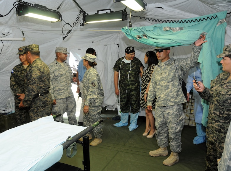 Key leaders from Joint Task Force-Bravo met with Honduran civic and military leaders at the Mobile Surgical Team's site of a Medical Readiness and Training Exercise (MEDRETE) being conducted in the town of Santa Rosa de Copan, Department of Copan, Honduras, May 7, 2014.  The Task Force and Honduran leaders engaged in discussions on how to build on the strong relationship between the U.S. and Honduras, how Joint Task Force-Bravo can continue to partner with Honduras in order to provide assistance to those in need and toured the Mobile Surgical Team's mobile operating room where U.S. and Honduran medical professionals were working side-by-side conducting gall bladder and hernia repair surgeries for eight local citizens.