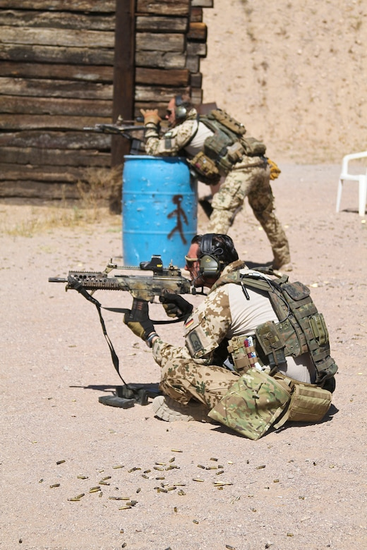 U.S. Airmen and Marines, along with German and Swedish Air Force Rangers, train together on various shooting tactics during Exercise ANGEL THUNDER at Three Points Firing Range in Tucson, Ariz., May 12, 2014.  ANGEL THUNDER is the only exercise in the Department of Defense covering personnel recovery training across the full spectrum of irregular and conventional warfare and has become the world's largest and most complex personnel recovery exercise. Through the use of joint training, members are able to hone their development of the four core functions of personnel recovery which include preparing, planning, execution, and adaptation. ANGEL THUNDER is designed to provide state of the art rescue training for the total Air Force rescue community, as well as Joint U.S. Military, federal government agencies, local communities, non-governmental agencies and allied nations.  (U.S. Air Force photo by Tech. Sgt. Heather R. Redman/Released)