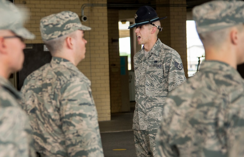 Staff Sgt. Eddie Glover, delivers commands to flight of basic trainees at the 322nd Training Squadron April 17, at Joint Base San Antonio-Lackland. Staff Sgt. Glover was named the 2014 Military Training Instructor of the Year.  (U.S. Air Force photo by Benjamin Faske) (released)