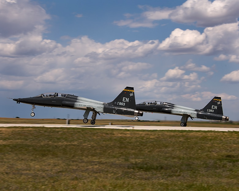 Air crews from the 80TH Flying Training Wing practice maneuvers during pilot training in T-38 Talon aircrafts on May 14, 2014 at Sheppard Air Force Base, Texas. Pilots practice take offs, landing, touch and goes and tactical formation. (U.S. Air Force photo by Danny Webb/Released)