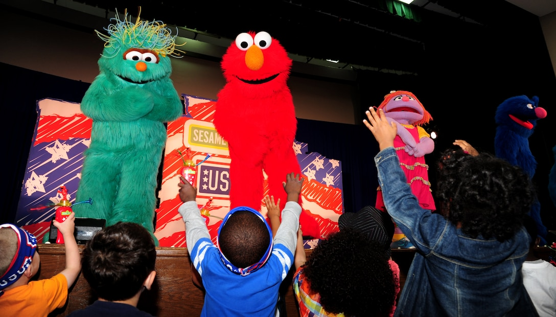 Joint Base Andrews families attend the Sesame Street/USO Experience for Military Families at Joint Base Andrews, Md., May 14, 2014. The seven month stateside tour began April 4 at Scott Air Force Base, Illinois, and is slated to perform more than 200 shows at 69 bases by the end of October.(U.S. Air Force photo/ Senior Airman Aaron Stout/released)