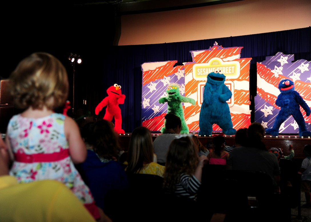 Joint Base Andrews families attend the Sesame Street/USO Experience for Military Families at Joint Base Andrews, Md., May 14, 2014. The seven month stateside tour began April 4 at Scott Air Force Base, Illinois, and is slated to perform more than 200 shows at 69 bases by the end of October.The performances, brought to them by the USO, told the story of Katie, a military child who just found out she will be relocating to a new place with her family. (U.S. Air Force photo/ Senior Airman Aaron Stout/released)