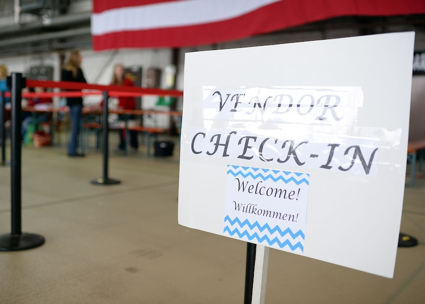Vendors report to the check-in station in Hangar 1 during the Spring Bazaar setup May 15, 2014, at Spangdahlem Air Base, Germany. More than 100 vendors will set up booths to sell wares from nearly a dozen different countries. The Spangdahlem Spouses and Enlisted Members Club hosts the Spring Bazaar every year, and last year they raised more than $50,000 directly for the Spangdahlem community. (U.S. Air Force photo by Staff Sgt. Daryl Knee/Released)