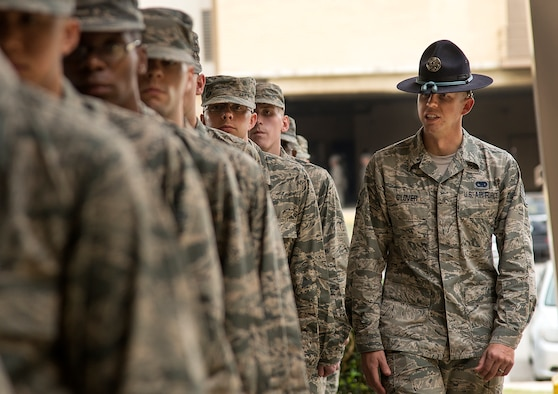 Staff Sgt. Eddie Glover, insures that a flight of basic trainees are properly aligned in formation at the 322nd Training Squadron April 17, at Joint Base San Antonio-Lackland. (U.S. Air Force photo by Benjamin Faske)