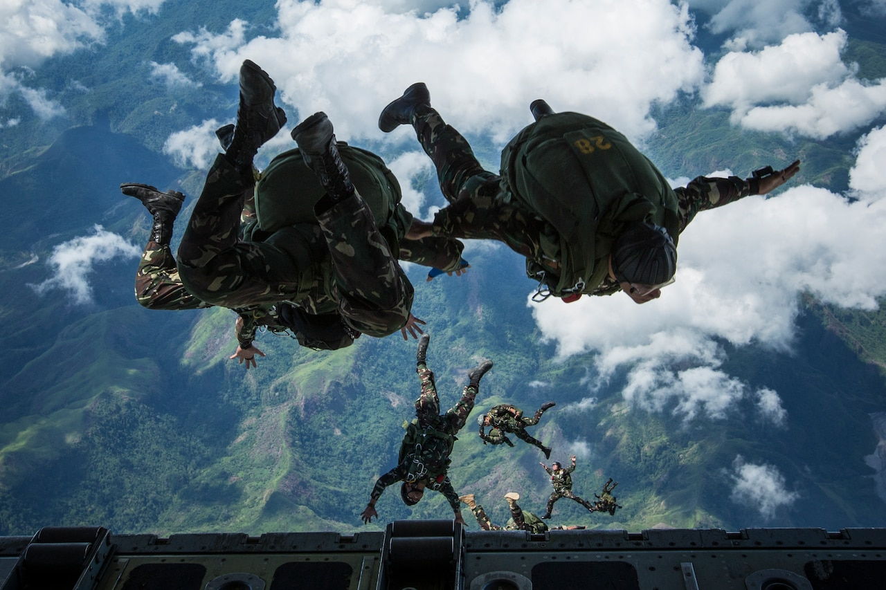 Soldiers jumping out of aircraft