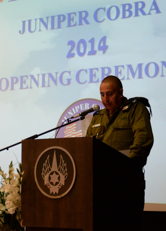 Israeli Defense Force Brig. Gen. Shachar Shohat speaks to a crowd of U.S. and Israeli service members during an opening ceremony for the Juniper Cobra 14 exercise May 15, 2014, at Hatzor Air Base, Israel.  The goal of JC14 is to exercise both nations' active missile defense forces and to improve their combined ability to defend against missile attacks. Shohat is the Air Defense Forces commander. (U.S. Air Force photo/Staff Sgt. Joe W. McFadden)
