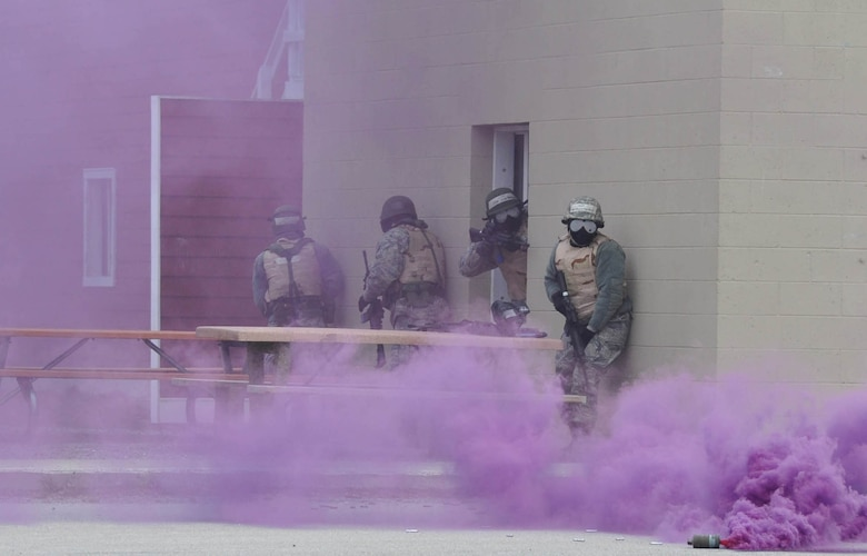 Airmen respond to a simulated gas attack during an urban warfare scenario May 12, 2014, at Alpena Combat Readiness Training Center in Alpena, Mich. The scenario was part of a four-day training deployment designed to prepare Airmen for future operations in a deployed environment. The Airmen are reservists from the 927th Mission Support Group.  (U.S. Air Force photo/Capt. Joe Simms)