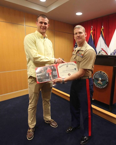 PITTSBURGH--Joseph Cosentino, a native of Pittsburgh and a graduate of Pittsburgh Central Catholic high school, received a Certificate of Appreciation for playing in the 2013 Semper Fidelis All-American Bowl from Maj. John Hunt, commanding officer of the United States Marine Corps Recruiting Station Pittsburgh, May 15. Following his senior year of high school Cosentino is slated to play for Florida State University, the champions of the 2013 college football season, as a quarterback. (U.S. Marine Corps photo by Lance Cpl. Brandon Thomas)