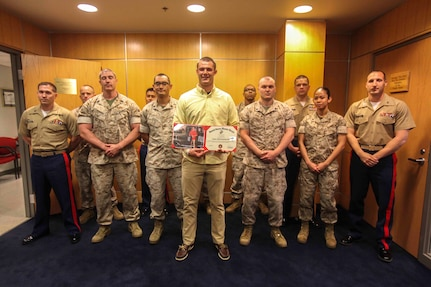 PITTSBURGH--Joseph Cosentino, a native of and a graduate of Pittsburgh Central Catholic high school, poses for a picture with the Marines from Recruiting Station Pittsburg after receiving a Certificate of Appreciation for playing in the 2013 Semper Fidelis All-American bowl from Maj. John Hunt, commanding officer of the United States Marine Corps Recruiting Station Pittsburgh, May 15. Following his senior year of high school Cosentino is slated to play for Florida State University, the champions of the 2013 college football season, as a quarterback. (U.S. Marine Corps photo by Lance Cpl. Brandon Thomas)re