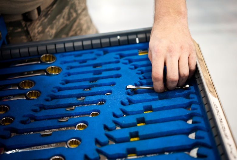 Senior Airman Daniel Hensley, 442nd Aircraft Maintenance Squadron electro-environmental technician from Sedalia, Missouri, grabs a wrench, May 15, 2014 at Whiteman Air Force Base, Missouri. Electro-environment technicians are responsible for performing and supervising aircraft electrical and environmental functions and activities. (U.S. Air Force photo by Senior Airman Daniel Phelps/Released)