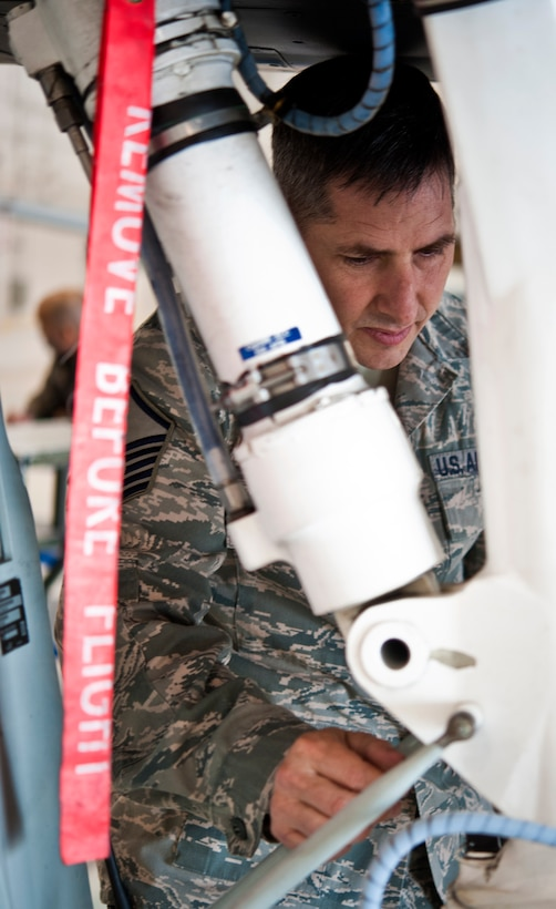 Master Sgt. Richard Hoff, 442nd Aircraft Maintenance Squadron electro-environmental technician from Sibley, Missouri, performs maintenance work on an A-10 Thunderbolt II, May 15, 2014 at Whiteman Air Force Base, Missouri. Electro-environment technicians are responsible for performing and supervising aircraft electrical and environmental functions and activities. (U.S. Air Force photo by Senior Airman Daniel Phelps/Released)