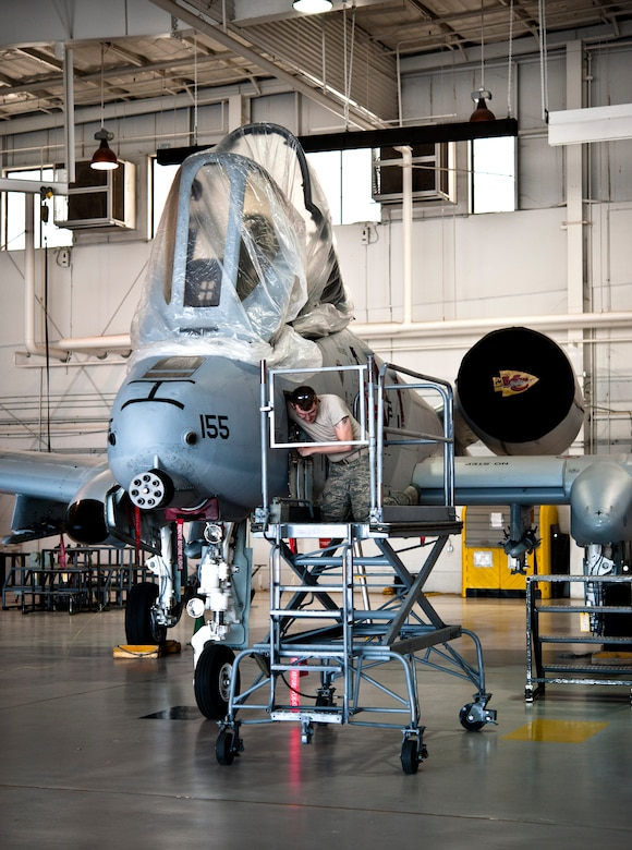 Senior Airman Daniel Hensley, 442nd Aircraft Maintenance Squadron electro-environmental technician from Sedalia, Missouri, performs maintenance work on an A-10 Thunderbolt II, May 15, 2014 at Whiteman Air Force Base, Missouri. Electro-environment technicians are responsible for performing and supervising aircraft electrical and environmental functions and activities. (U.S. Air Force photo by Senior Airman Daniel Phelps/Released)