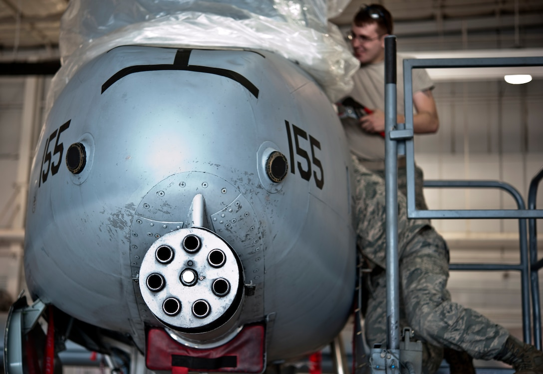 Senior Airman Daniel Hensley, from Sedalia, Missouri, and Master Sgt. Richard Huff, from Sibley, perform maintenance work on an A-10 Thunderbolt II May 15, 2014 at Whiteman Air Force Base, Missouri. Hensley and Hoff are both assigned to the 442nd Aircraft Maintenance Squadron electro-environmental shop. (U.S. Air Force photo by Senior Airman Daniel Phelps/Released)