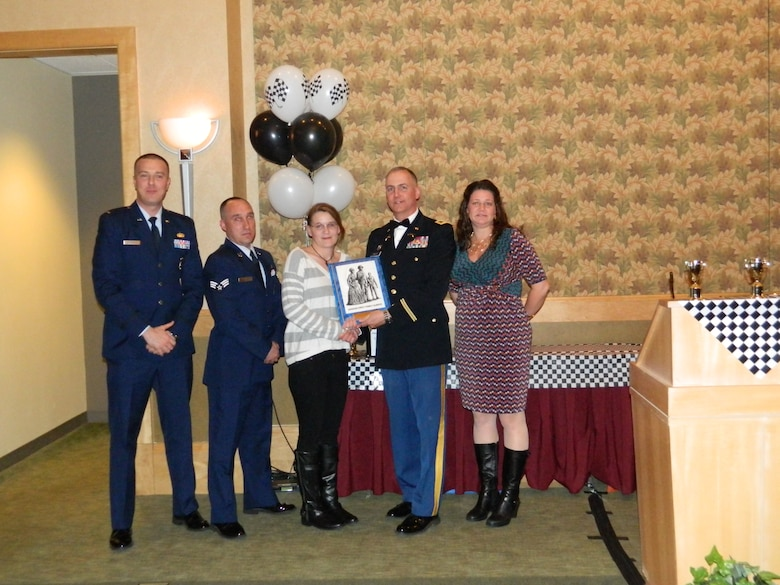 Kimberly healy receives the 2014 Massachusetts Air  National Guard's Outstanding Family Readiness and Support Award.
