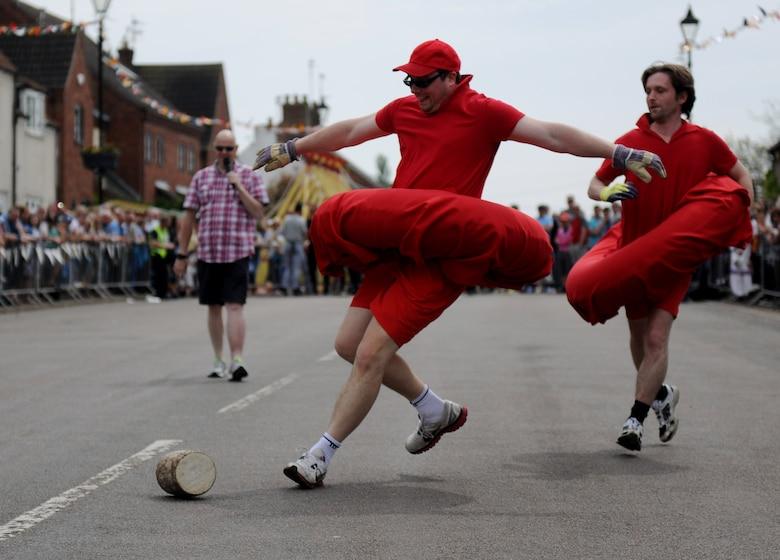 A competitor attempts to keep a wooden log on track during the 50th Annual Stilton Cheese Rolling Festival at Stilton Village, United Kingdom, May 5, 2014. The tradition of cheese rolling began at Stilton in 1964 when local landlords created the event as a means to revive tourism and commerce in the village. (U.S. Air Force photo by Staff Sgt. Jarad A. Denton/Released)
