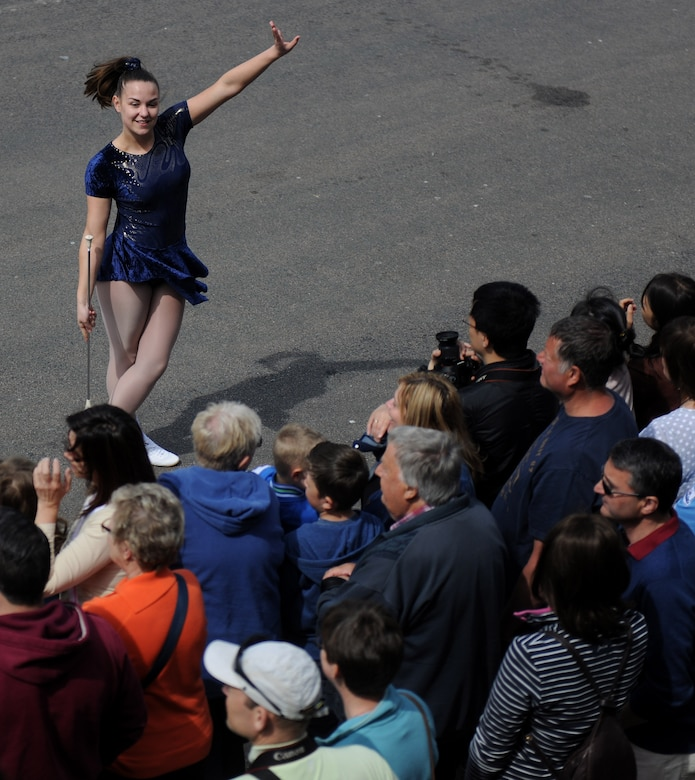 A baton twirler completes her routine during the 50th Annual Stilton Cheese Rolling Festival, Stilton Village, United Kingdom, May 5, 2014. While the festival centers on the tradition of cheese rolling, several local vendors and performers came out to entertain and entice the crowd. (U.S. Air Force photo by Staff Sgt. Jarad A. Denton/Released)