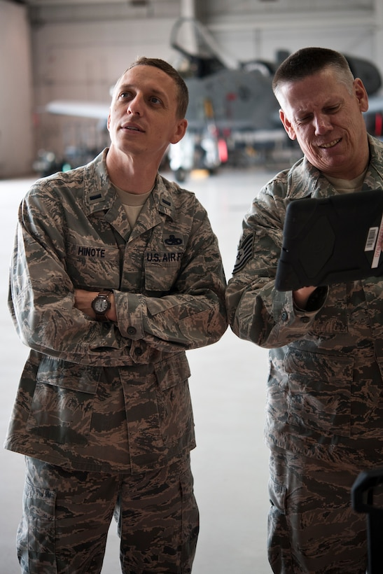 1st Lt. Chris Hinote, 442nd Aircraft Maintenance Squadron officer, goes over tasking orders with Tech. Sgt. Dave Ward, 717th Aircraft Maintenance Squadron electro-environmental technician, May 14, 2014, at Whiteman Air Force Base, Missouri. Hinote was the Company Grade Officer of the Quarter for the first quarter of 2014. (U.S. Air Force photo by Senior Airman Daniel Phelps/Released)