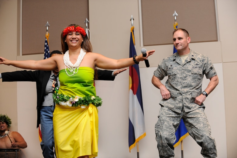 Team Buckley members learn traditional pacific-island dances during Buckley's Asian-American Pacific Islander Heritage Month Celebration May 14, 2014, at the leadership development center on Buckley Air Force Base, Colo. The ceremony also included a guest speaker, traditional pacific island and Asian food samples, and dances performed by the Polynesian dance troupe, Halau Kalama. (U.S. Air Force photo by Airman 1st Class Samantha Saulsbury/Released)