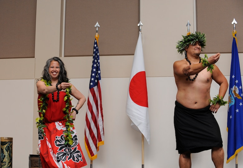 Polynesian dance group, Halau Kalama, perform during Buckley's Asian-American Pacific Islander Heritage Month Celebration May 14, 2014, at the leadership development center on Buckley Air Force Base, Colo. The ceremony also included a guest speaker and traditional pacific island and Asian food samples. (U.S. Air Force photo by Airman 1st Class Samantha Saulsbury/Released)