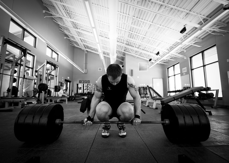 Staff Sgt. Jeffrey Zastrow, of the 96th Medical Group, prepares to deadlift more than 400 pounds as part of his training regime for the Air Force wrestling team May 16 at Eglin Air Force Base, Fla.  The 33-year-old bioenvironmental engineer recently won the 98 kg division of the U.S. Veteran's National Championship held in Las Vegas.  (U. S. Air Force photo/Samuel King Jr.)
