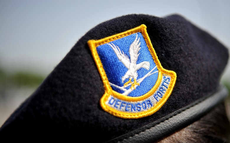"The ""defensor fortis"" flash stands out against the blue beret of Senior Master Sgt. Roelma Wood, 51st Security Forces Squadron, during the Police Week retreat ceremony at Osan Air Base, Republic of Korea, May 16, 2014. ""Defensor fortis"" is Latin for ""defenders of the force."" (U.S. Air Force photo/Airman 1st Class Ashley J. Thum)"