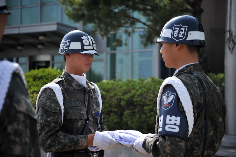 Members of the Republic of Korea air force air police fold the Korean flag during the Police Week retreat ceremony at Osan Air Base, ROK, May 16, 2014. Police Week is an annual tradition centered around National Peace Officers Memorial Day, observed on May 15. (U.S. Air Force photo/Airman 1st Class Ashley J. Thum)