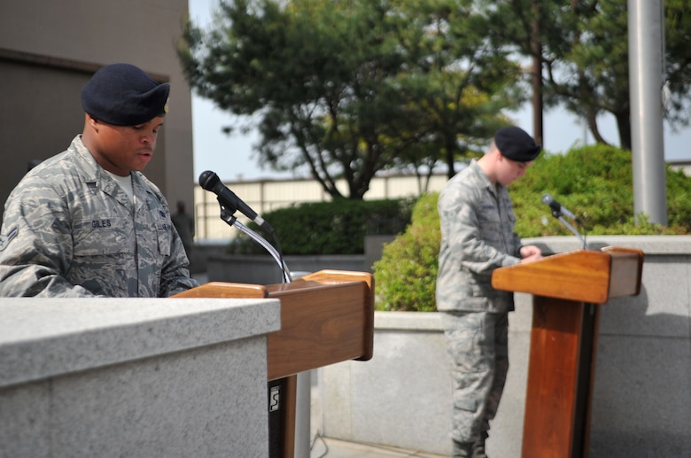 Airmen from the 51st Security Forces Squadron read the names of fallen law enforcement officers during the Police Week retreat ceremony at Osan Air Base, Republic of Korea, May 16, 2014. The names of fallen ROK military law enforcement officers and Korean National Police officers were also included. (U.S. Air Force photo/Airman 1st Class Ashley J. Thum)