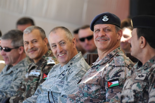 His Royal Highness Prince Faisal bin al-Hussein of Jordan, right, watches a first-run attack competition with U.S. Air Force Maj. Gen. Mike Edwards, adjutant general of the Colorado Air National Guard, center, during Exercise Eager Tiger May 14, 2014, at an air base in northern Jordan. This year marks the 10th year the COANG and Jordan have been paired under the National Guard Bureau's State Partnership Program. (U.S. Air Force photo by Staff Sgt. Brigitte N. Brantley/Released)