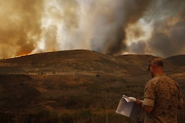 Brig. Gen. John W. Bullard surveys the fire in the Las Pulgas Area. The Las Pulgas fire started at 3:15 p.m. Thursday and effected Camp las Pulgas, Camp Margarita, Camp Las Flores, the 32 Area, the 22 Area and the 23 Area. Camp Las Pulgas was evacuated to the School of Infantry parade deck, Camp Las Flores, Camp Margarita and the 32 Area were evacuated to the I MEF parade deck in Camp Del Mar. The 22 and 23 Areas were ordered to shelter in place. Bullard is the commanding general of Marine Corps Installations West and Marine Corps Base Camp Pendleton.