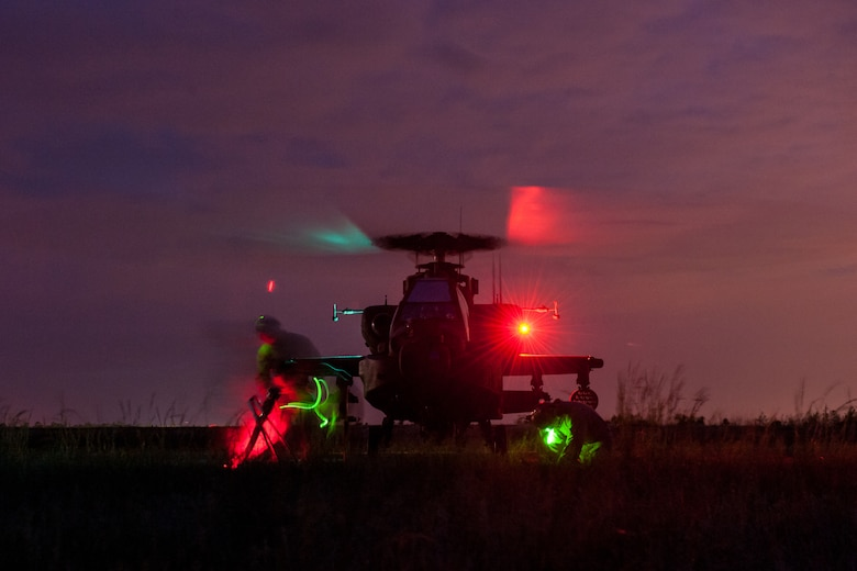 U.S. Marines assigned to the 273rd Marine Wing Support Squadron, Air Operations Company, from Marine Corps Air Station Beaufort, S.C., fuel a South Carolina National Guard AH-64 Apache at a forward air refueling point at McEntire Joint National Guard Base, S.C. on May 14, 2014.  Elements of the South Carolina Air and Army National Guard and the U.S. Marines conduct joint operations which are crucial to the ongoing success of operational readiness and deployments around the world.  (U.S. Air National Guard photo by Tech Sgt. Jorge Intriago/Released)