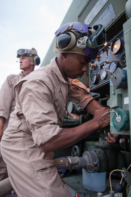 U.S. Marine Cpl. Eric A. Robinson, assigned to the 273rd Marine Wing Support Squadron, Air Operations Company, stops the transfer of fuel from an N-90 fuel truck to a rotary wing aircraft during forward air refueling point operations at McEntire Joint National Guard Base, S.C. on May 14, 2014. Elements of the South Carolina Air and Army National Guard and the U.S. Marines conduct joint operations which are crucial to the ongoing success of operational readiness and deployments around the world.  (U.S. Air National Guard photo by Tech Sgt. Jorge Intriago/Released)