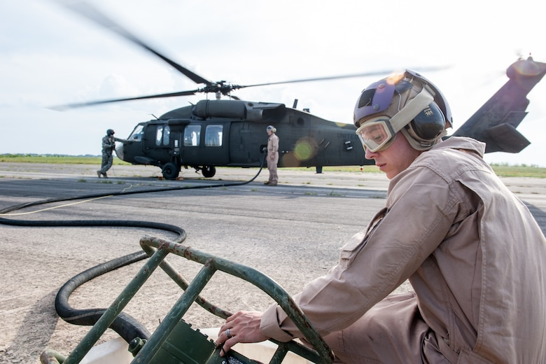 U.S. Marine Cpl. Michael T. Ransom, assigned to the 273rd Marine Wing Support Squadron, Air Operations Company, monitors the amount of fuel transferred to the UH-60 Blackhawk during forward air refueling point operations at McEntire Joint National Guard Base, S.C. on May 14, 2014. Elements of the South Carolina Air and Army National Guard and the U.S. Marines conduct joint operations which are crucial to the ongoing success of operational readiness and deployments around the world.  (U.S. Air National Guard photo by Tech Sgt. Jorge Intriago/Released)