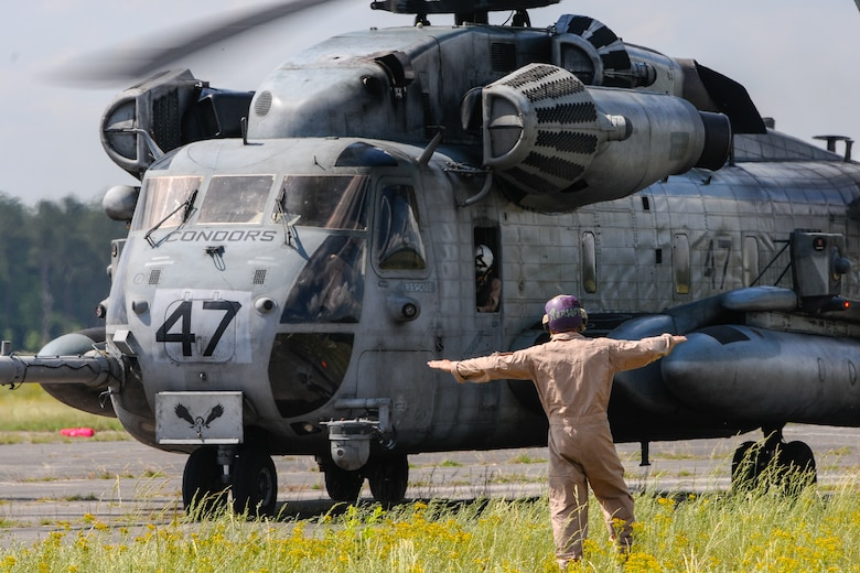 A U.S. Marine assigned to the 273rd Marine Wing Support Squadron, Air Operations Company, marshals a CH-53 Sea Stallion during forward air refueling point operations at McEntire Joint National Guard Base, S.C. on May 14, 2014. Elements of the South Carolina Air and Army National Guard and the U.S. Marines conduct joint operations which are crucial to the ongoing success of operational readiness and deployments around the world.  (U.S. Air National Guard photo by Tech Sgt. Jorge Intriago/Released)