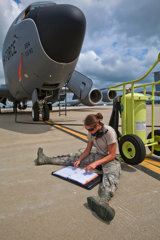 Senior Airman Ashley V. King, an aircraft fuel systems journeyman with the 108th Wing Aircraft Maintenance Squadron, reviews her checklist as 108th Wing Petroleum, Oils and Lubricants refuels a KC-135R Stratotanker at Joint Base McGuire-Dix-Lakehurst, N.J., May 15, 2014. (U.S. Air National Guard photo by Master Sgt. Mark C. Olsen/Released)