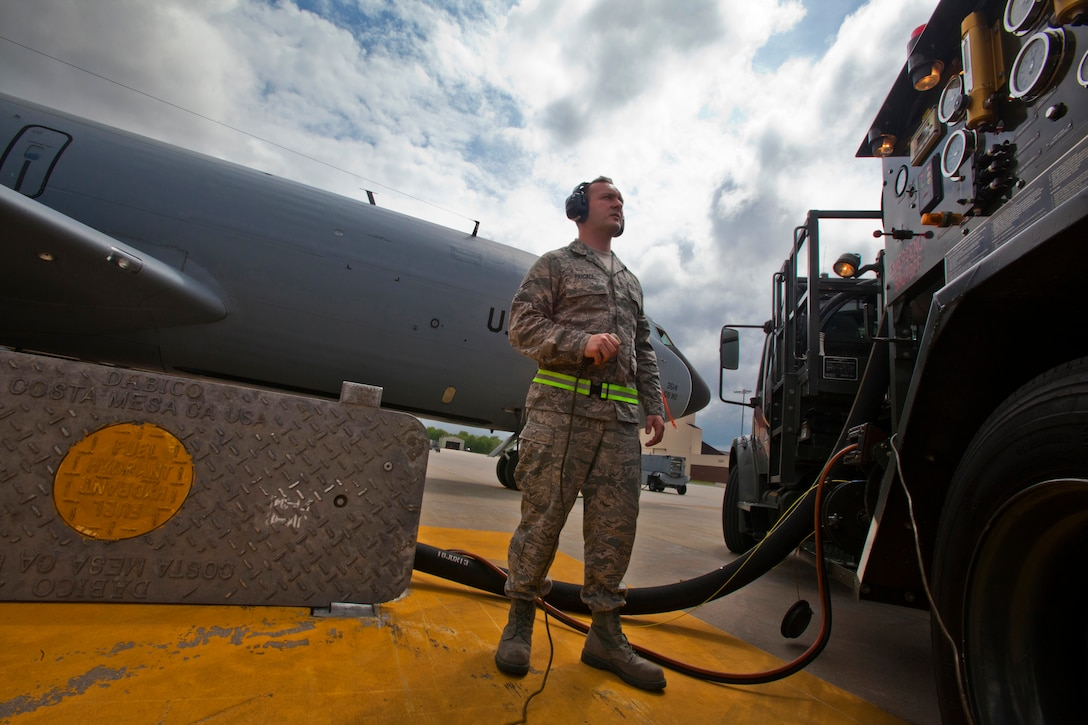 Senior Airman Victor T. Pascale, a fuels journeyman with the Petroleum, Oils and Lubricants shop, 108th Wing Logistics Readiness Squadron, checks the gauges on his R-12 hydrant-servicing vehicle while fueling a KC-135R Stratotanker at Joint Base McGuire-Dix-Lakehurst, N.J., May 15, 2014. (U.S. Air National Guard photo by Master Sgt. Mark C. Olsen/Released)