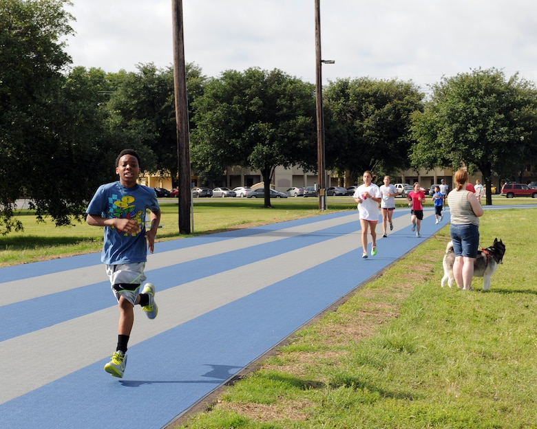 Barksdale children run on the Senior Airman Bryan R. Bell Fitness Center track during a two-mile Kids Run on Barksdale Air Force Base, La., May 17, 2014. More than 100 Team Barksdale members participated in the Kids Run. (U.S. Air Force photo/Senior Airman Benjamin Gonsier)