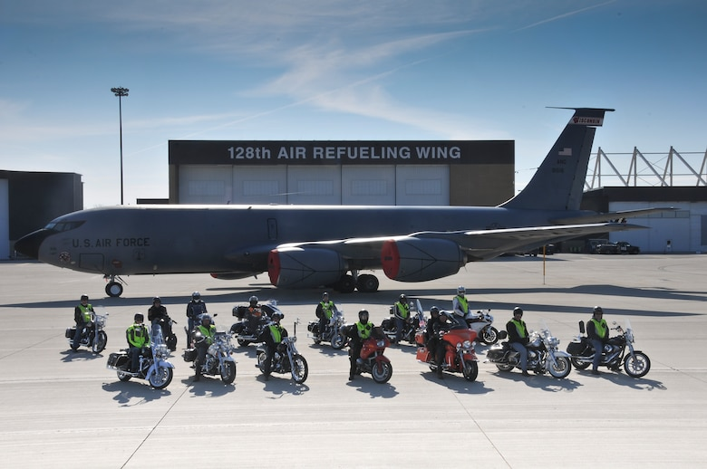 After successfully completing a motorcycle safety course, a group of motorcyclists pose with their motorcycles and a KC-135R Stratotanker on the 128th Air Refueling Wing's ramp, Milwaukee, May 17, 2014. (U.S. Air National Guard photo by Staff Sgt. Jeremy Wilson/Released)