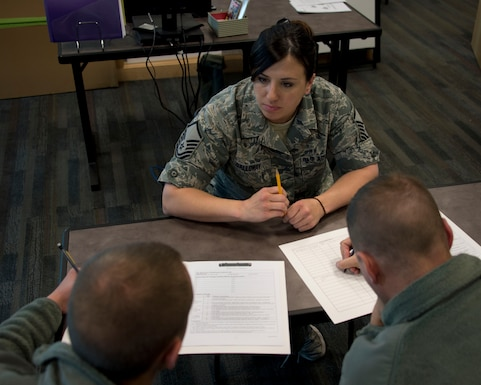 Master Sgt. Crystal Galloway, center, goes over Individual Training Records with Airman 1st Class Peter Robey and Airman 1st Class John Schonebaum in St. Paul, Minn., May 6, 2014. Galloway is the Unit Training Manager and is responsible for keeping track of the training records for the 133rd Maintenance Group. (U.S. Air National Guard photo by Tech. Sgt. Amy M. Lovgren/Released)
