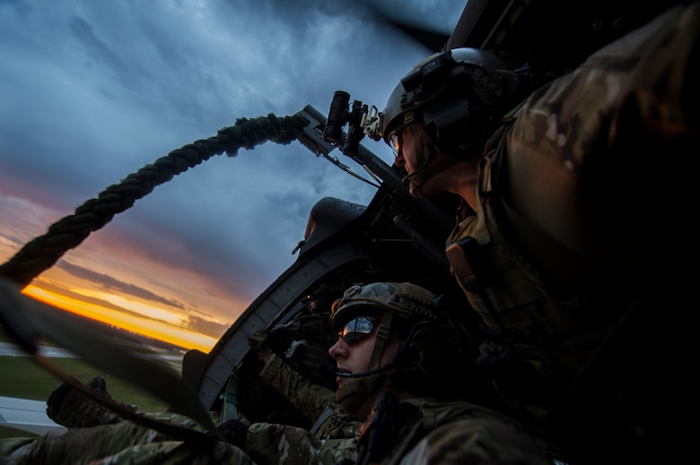 Soldiers with the 20th Special Forces Group observe the scenery before fast-roping from a UH-60 Black Hawk helicopter during Emerald Warrior 14 in Gulfport, Miss., April 30, 2014. Emerald Warrior is a U.S. Special Operations Command-sponsored two-week joint/combined tactical exercise designed to provide realistic military training in an urban setting. (U.S. Air Force photo/Senior Airman Jodi Martinez)