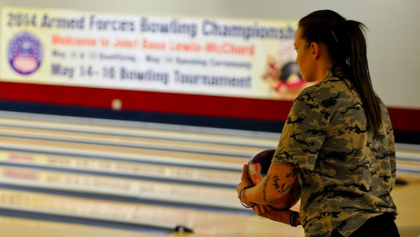 Sgt. Rose Brown, stationed at Fort Bliss, Texas, competes against the All-Air Force and All-Navy Bowling teams during the 2014 Armed Forces Bowling Championship at Bowl Arena Lanes on Joint Base Lewis-McChord, Wash., May 13. Soldiers from across the Army competed for a chance to bowl on the All-Army Bowling team against the All-Air Force and All-Navy teams.