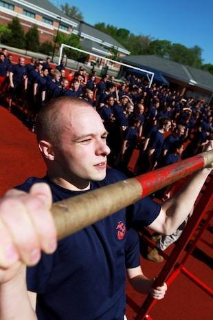 Brent Holmes, a Plymouth, Mass., native, preforms pull-ups during the 2014 Annual Field Meet, at Chicopee High School's Football Field, May 17, 2014. Approximately 450 newly enlisted men and women from across New England, to include; Western Massachusetts, Connecticut, and Rhode Island, attended the event. The annual Marine Corps event is designed to test the Poolees' physical fitness with a pull-up and sit-up competition to ensure that they are prepared for the rigors of Marine Corps boot camp. (Official Marine Corps Photo by Sgt. Richard Blumenstein)