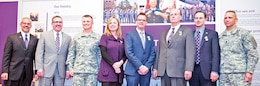 From left, K-State Director of Military Affairs Art DeGroat; K-State President Kirk Schulz; Maj. Gen. Paul E. Funk II, commanding general, 1st Inf. Div. and Fort Riley; Briana Nelson-Goff, K-State Human Ecology Department; Todd Holmberg, director, McCain Auditorium; Daryl Youngman, K-State associate professor; and K-State Athletics Director John Currie pose for a photo after receiving the Department of the Army's Outstanding Civilian Service Award.