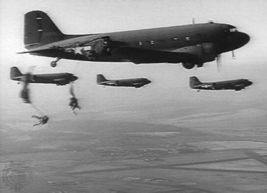 Paratroopers from the 503rd Regimental Combat Team jump from 317th Troop Carrier Group C-47s during the recapture of Corregidor Island, Philippines, in February 1945. Despite concentrated anti-aircraft and small arms fire, the 317th delivered the paratroopers over the target sustaining battle damage to more than half of its 51 aircraft. The assault on Corregidor was the most intense combat action in which the 503rd PIR engaged in during its history. During the airborne phase of the battle 12 paratroopers were killed and 267 were wounded.  Both units were awarded Presidential Unit Citations for their actions in retaking Corregidor Island. (Courtesy photo)